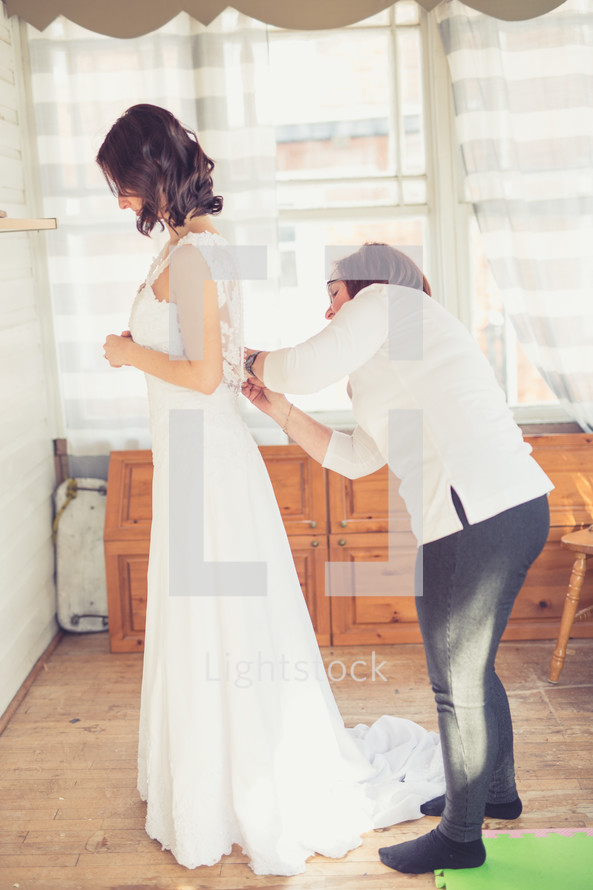 seamstress altering a wedding dress
