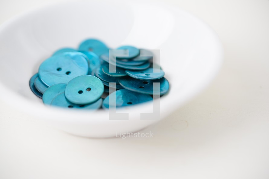 bowl of blue buttons