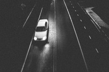 car driving on a street at night