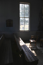 sunlight on church pews in an old church