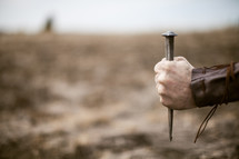 man holding a nail