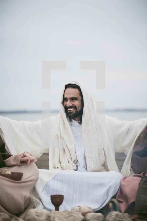 Jesus sitting offering communion