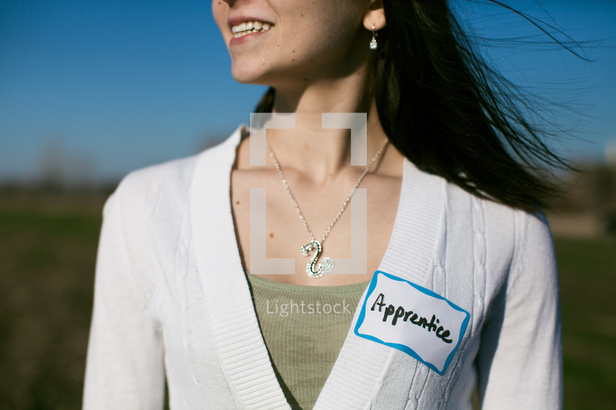 woman wearing an apprentice name tag