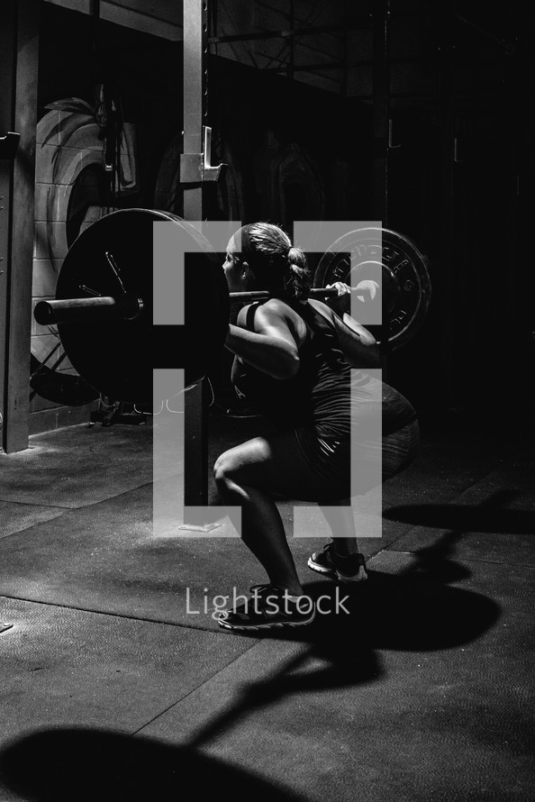 woman doing a back squat
