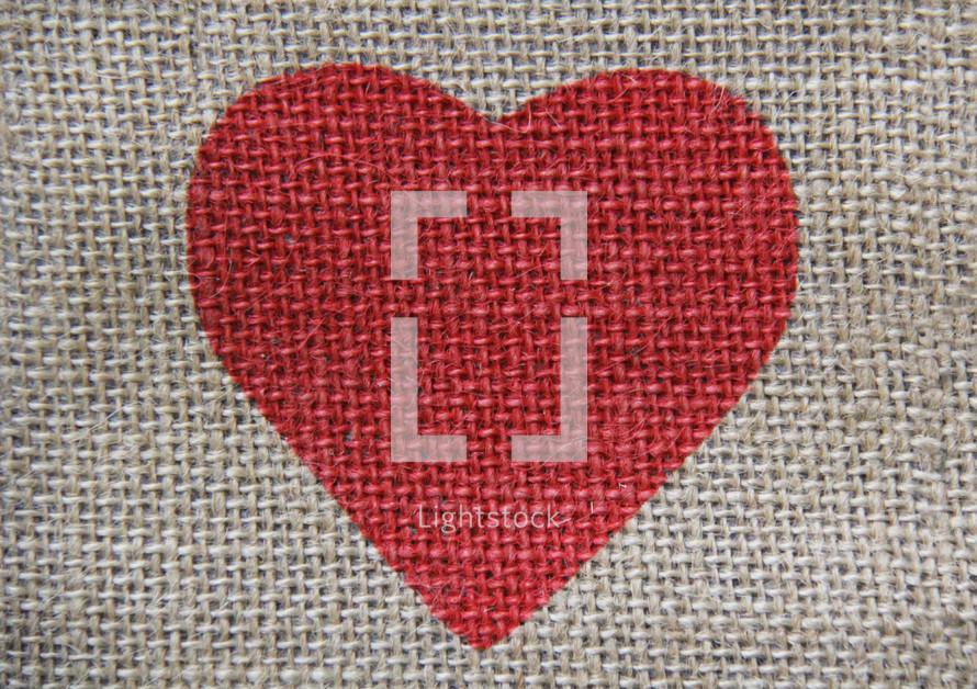 red valentine heart on burlap