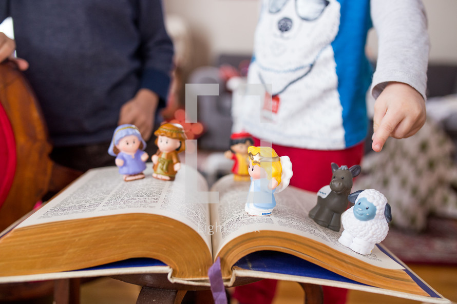 toy manger Biblical figures on a Bible
