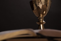 gold chalice and Bible