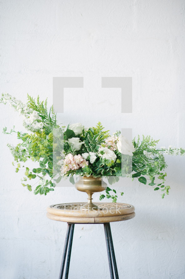 flowers in a vase on a side table