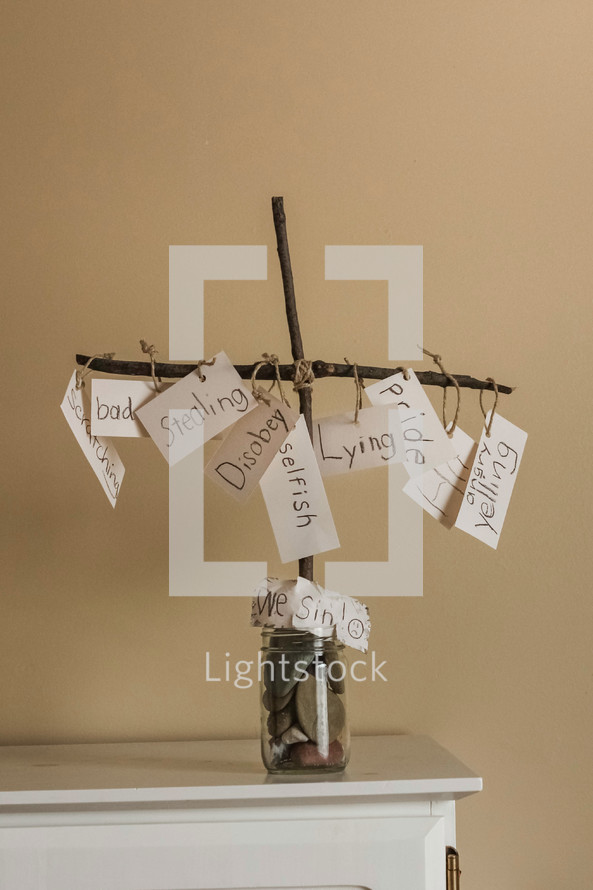 sins hanging from a cross