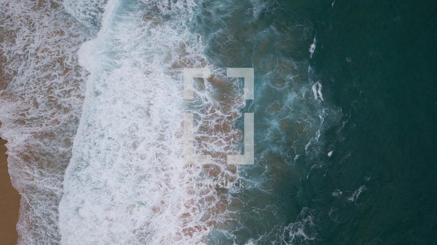aerial view over a beach shore