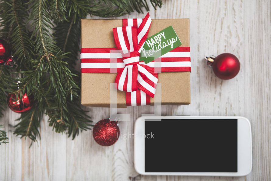 christmas gift background with smartphone
