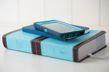teal Bible, journal, and cellphone