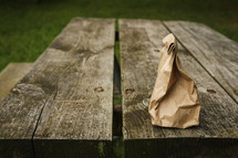 lunch sack on a picnic table