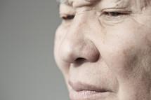 Face of elderly man looking away.