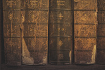 Old weathered books on a shelf