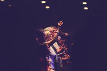 parishioners praising God during a worship service