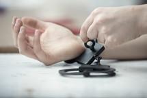 taking off hand-cuffs