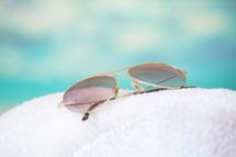 sunglasses on a towel