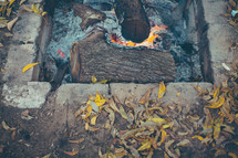 ashes and embers in a fire pit