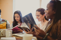 women reading Bibles at a woman's group Bible study
