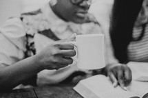woman reading a Bible at a woman's Bible study