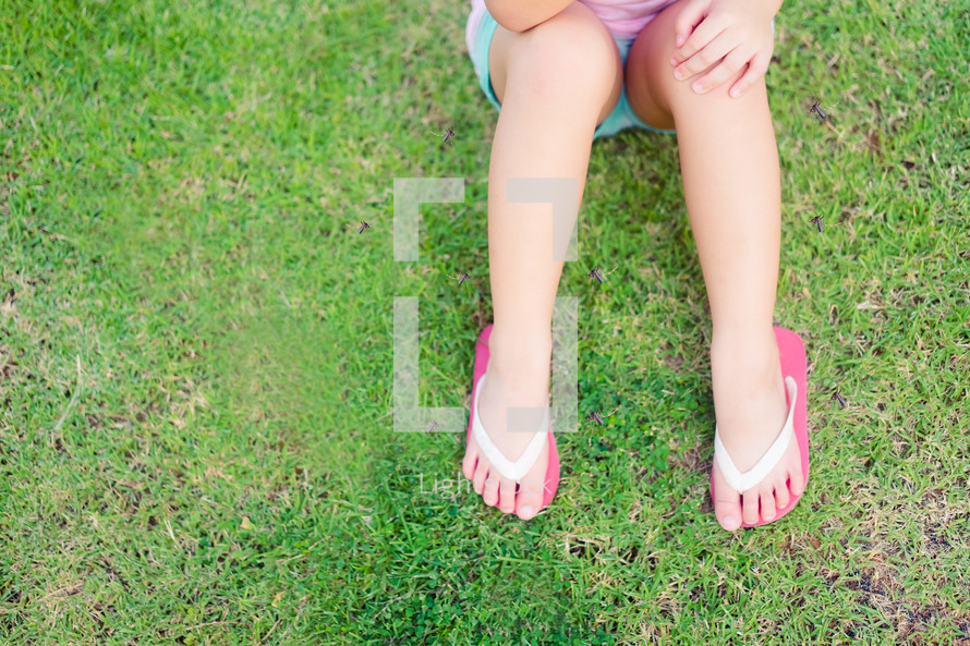 flip flops in the grass