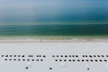 view of lounge chairs in rows on a beach