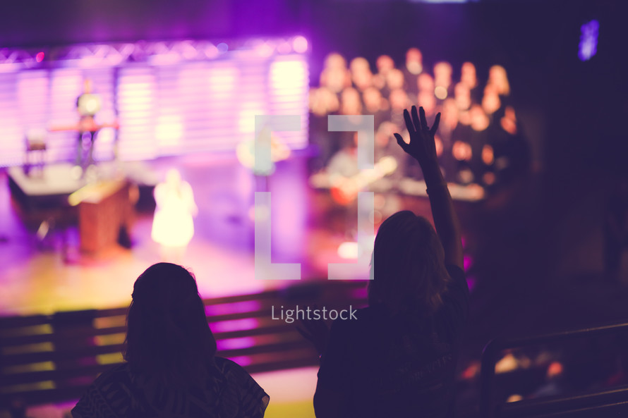 raised hands during a contemporary worship service