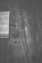 An open Bible on wood
