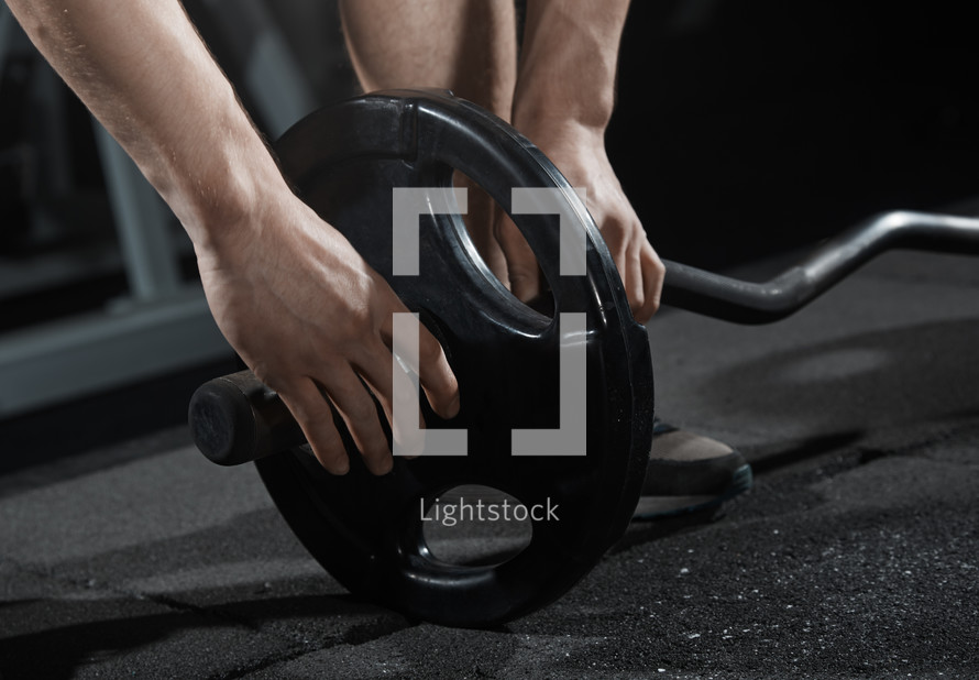 lifting weights at the gym