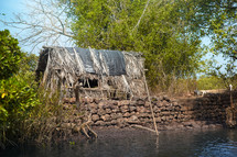 straw hut along a river