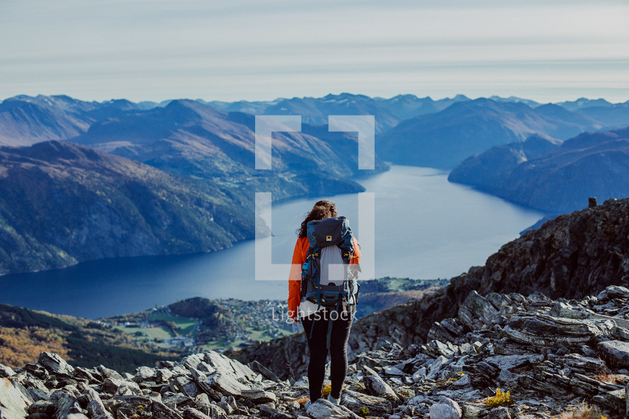 woman backpacking on a mountain