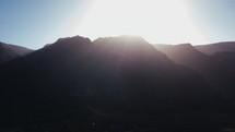 sunlight behind mountains