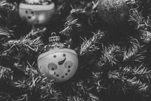 Snowman Christmas ornaments on greenery