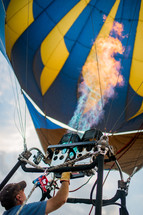 A man operating a hot air balloon.