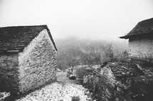 snow on cabins