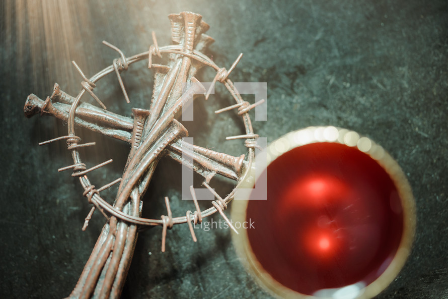 Holy communion on wooden table on church.Taking Communion.Cup of glass with red wine, bread and Holy Bible and Cross on wooden table.The Feast of Corpus Christi Concept.
