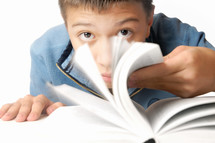 a boy reading an interesting book
