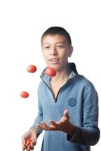 boy juggling balls