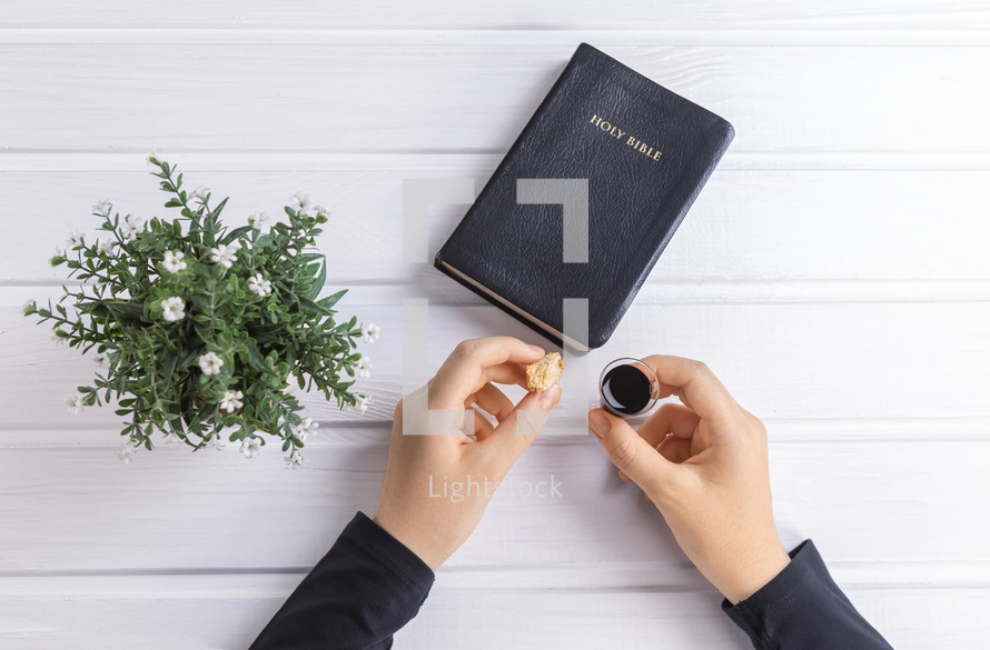Bibles, hands and communion elements