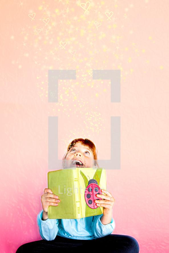 a girl reading a children's Bible