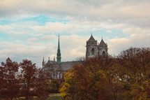 a cathedral and fall trees