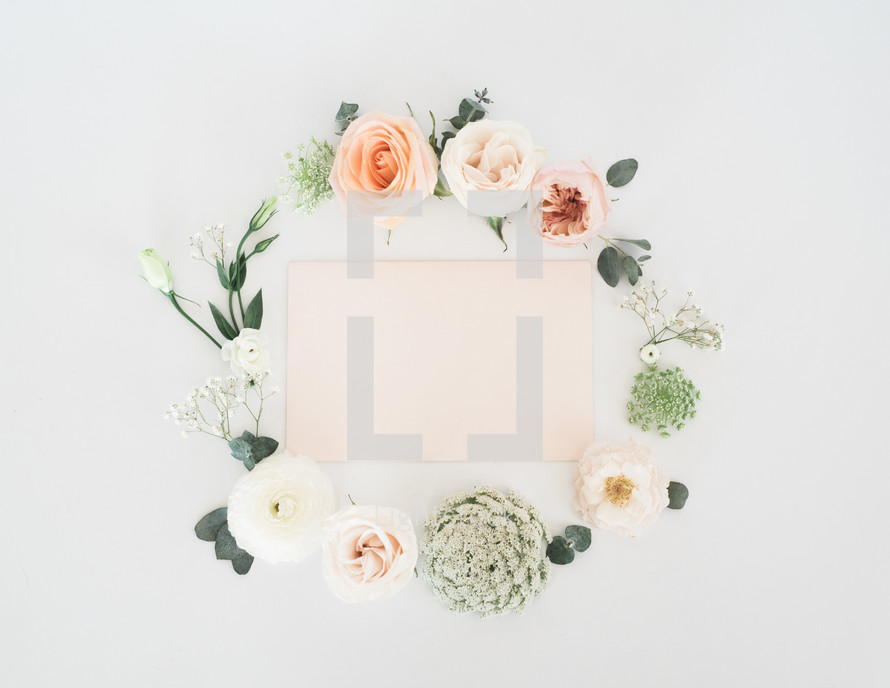 wreath of flowers around a frame