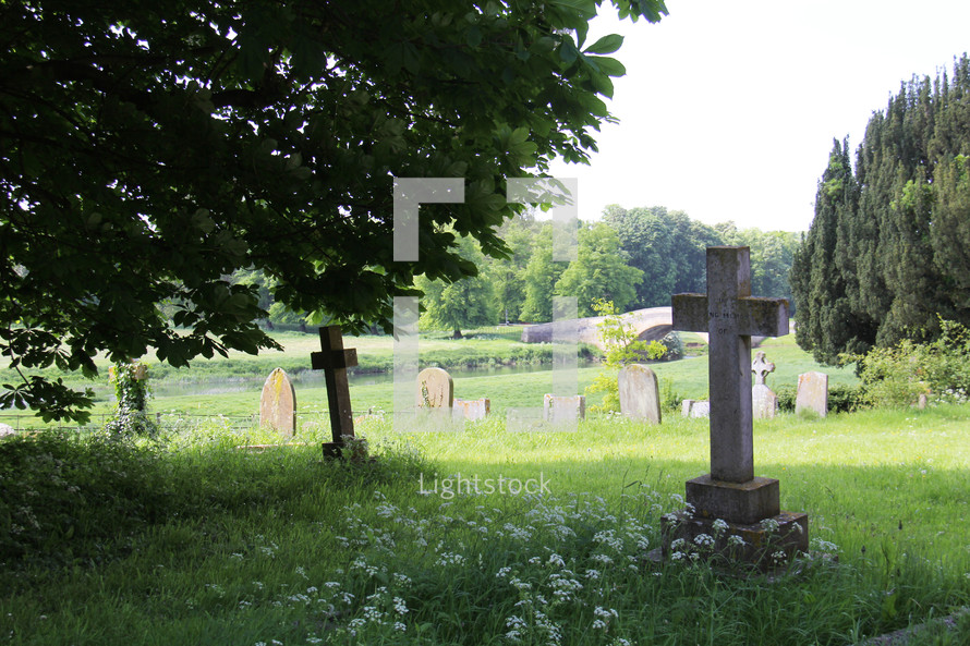 cross tombstones in a cemetery
