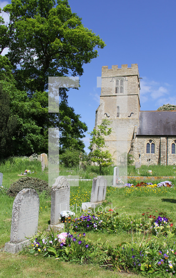 old cemetery in front of a stone church