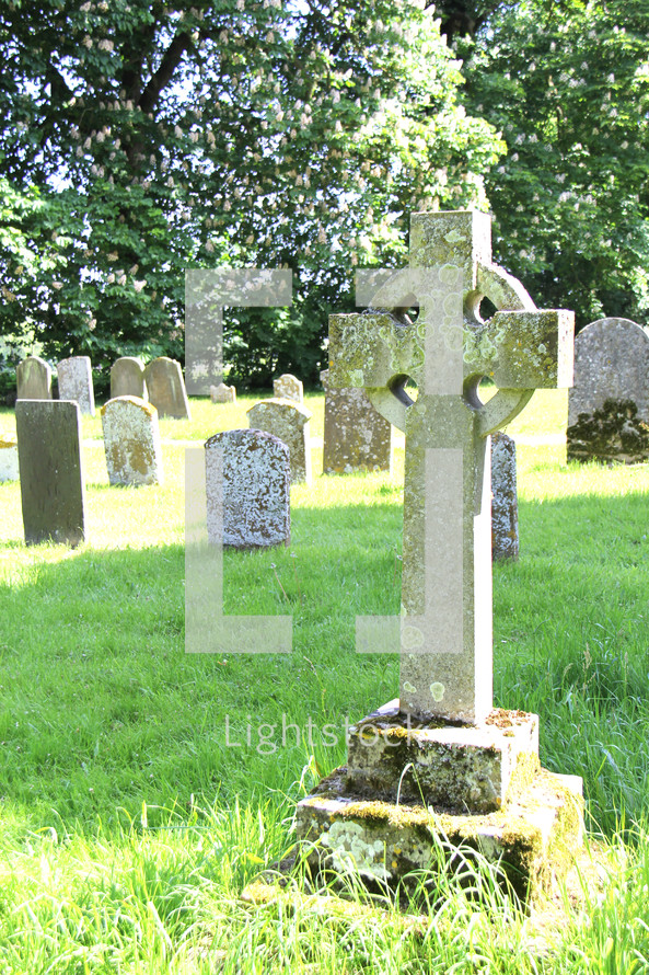 cross tombstones in an old cemetery