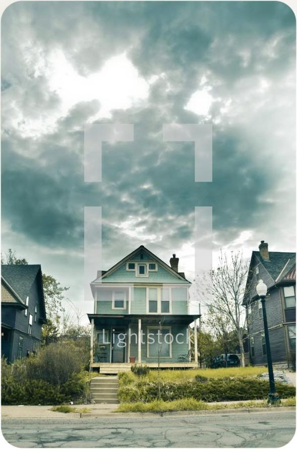 House under a stormy sky.