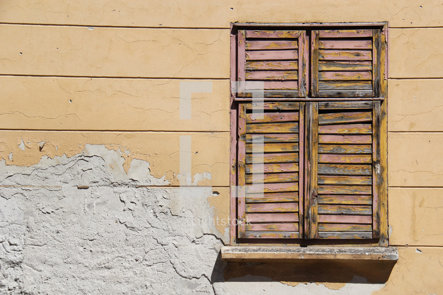 closed shutters on an old window