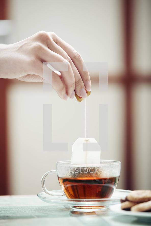 woman brewing tea