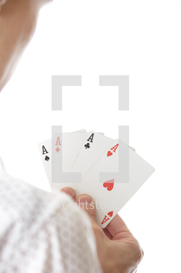 man holding aces